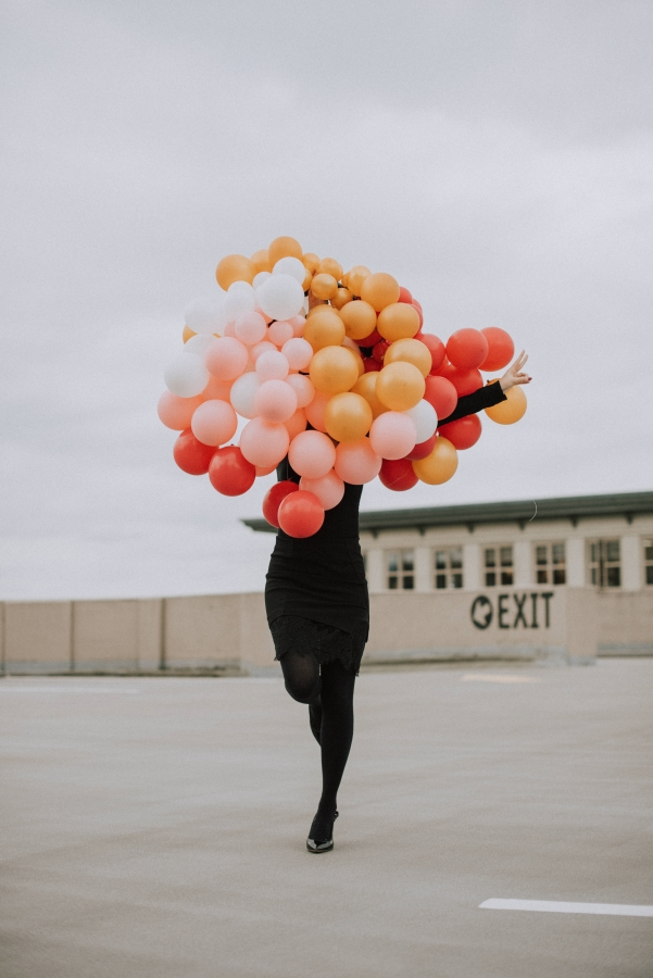 Posing with a bouquet of balloons in my little black dress for my 25th birthday