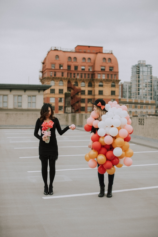 Posing with a balloon bouquet in my little black dress with my friend wearing my balloon skirt