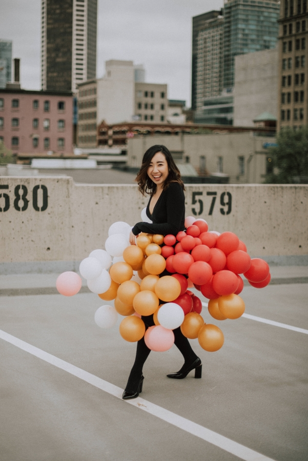 Smiling because it's my 25th birthday with my ultimate birthday checklist and balloon skirt