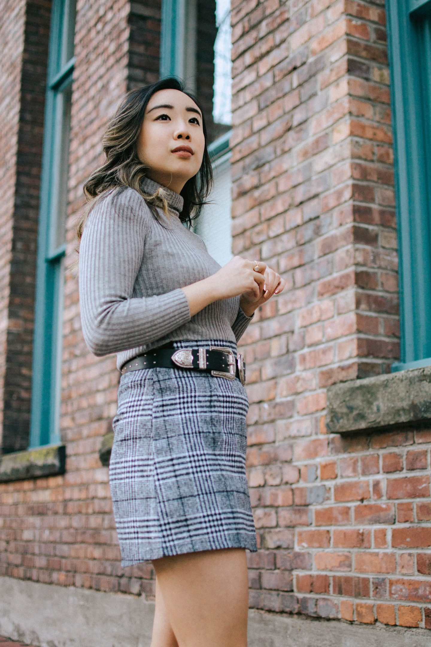1 piece 2 ways - wearing my checkered mini skirt with booties belt and grey turtleneck