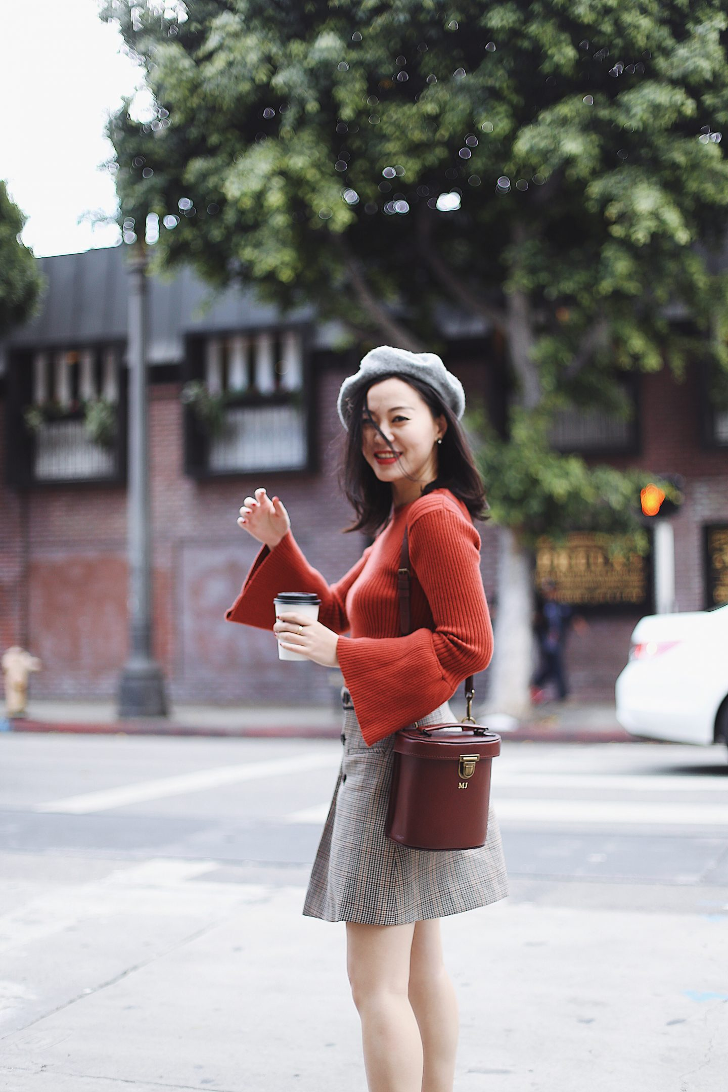 1 piece 2 ways - pairing checkered skirt with beret brown bag and bell sleeved red top