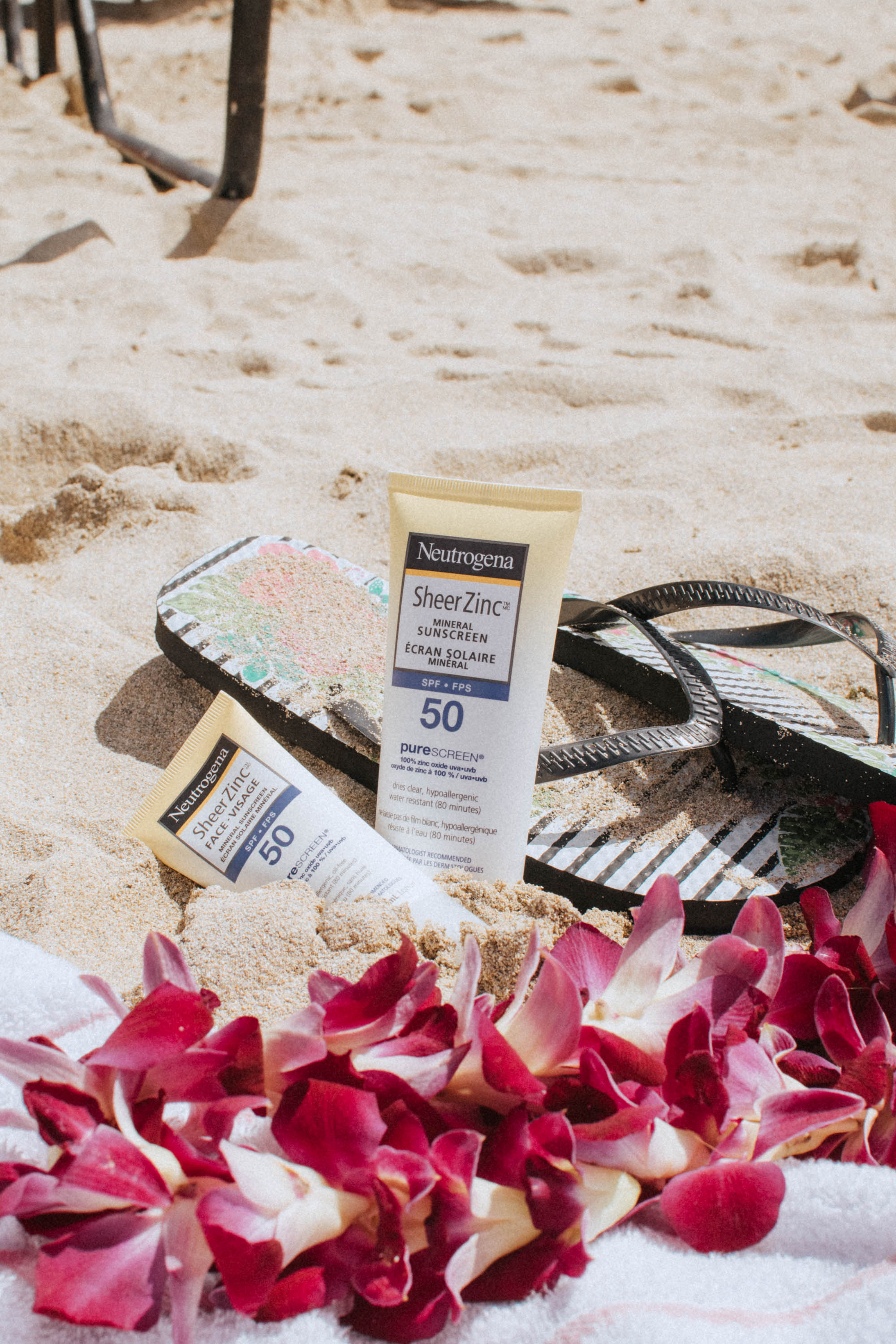 Displaying my favourite Neutrogena Sheer Zinc Mineral Sunscreen for Face and Body by the beach