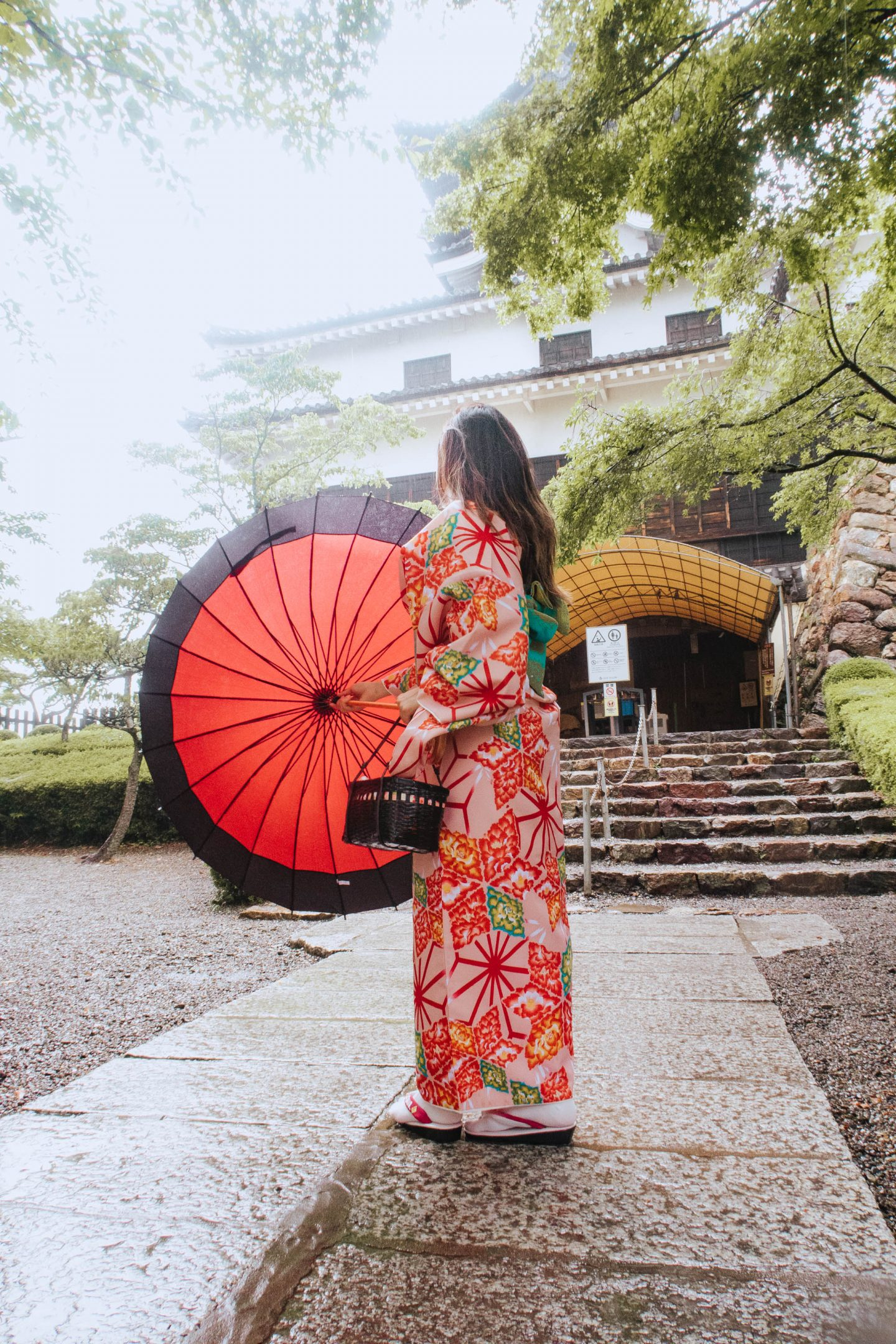 Trying on traditional silk Kimonos and umbrellas in Nishio Central Japan