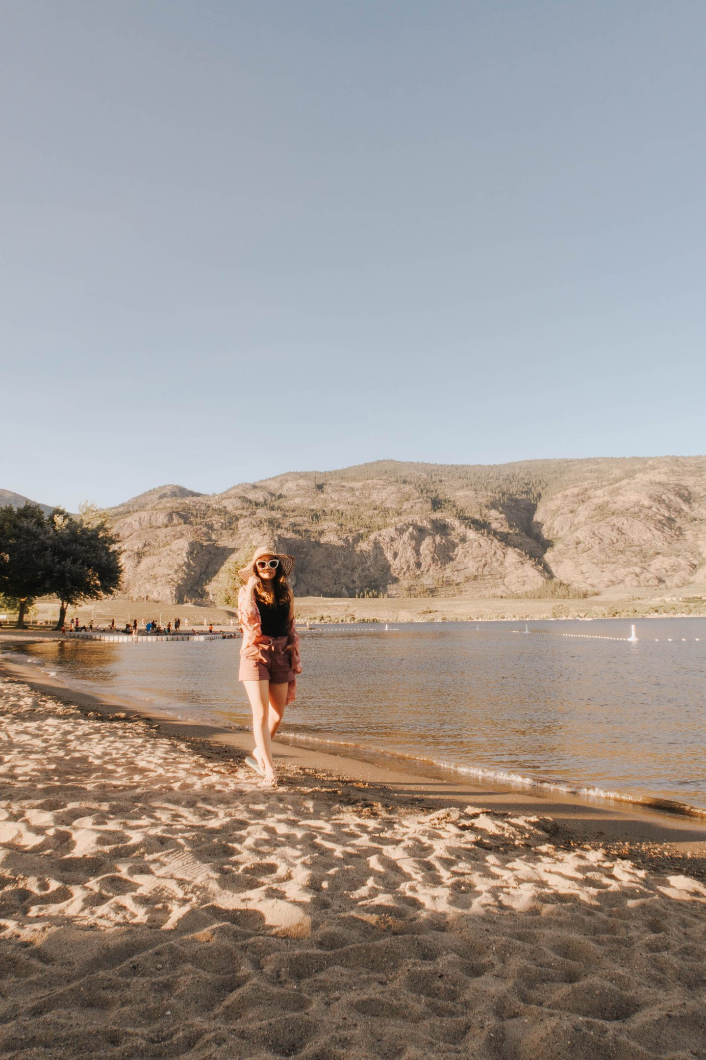 Strolling on the beach with mountain views at The Watermark Resort in Osoyoos BC Okanagan