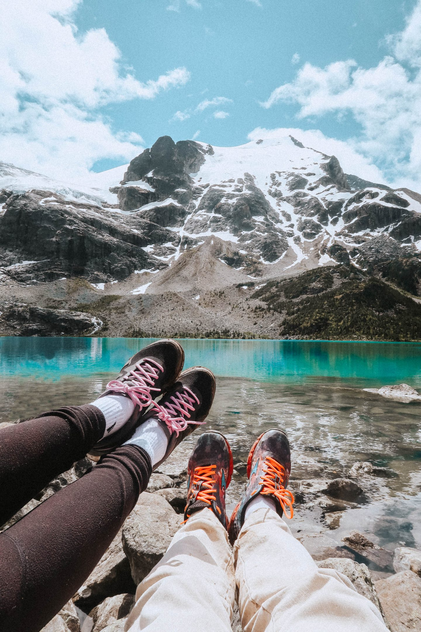 Showing our hiking shoes near Joffre Lakes and mountains