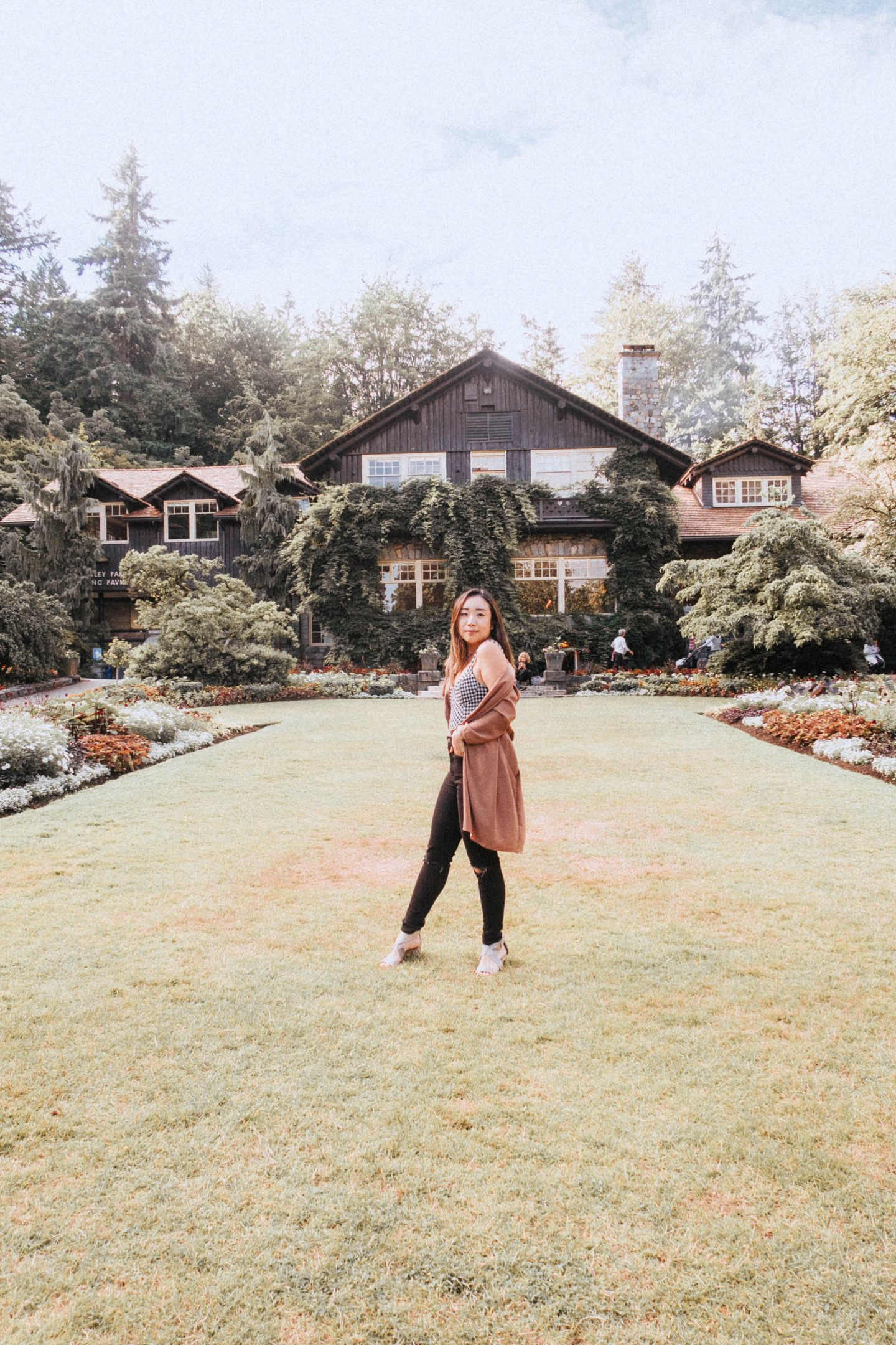 In front of the famous house in Stanley Park in Vancouver BC