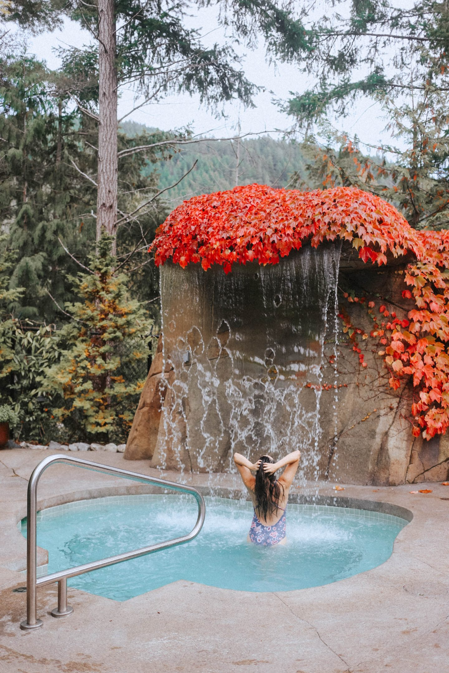 Enjoying the hot tub with rainfall feature at The Spa at the Painted Boat Resort Sunshine Coast BC