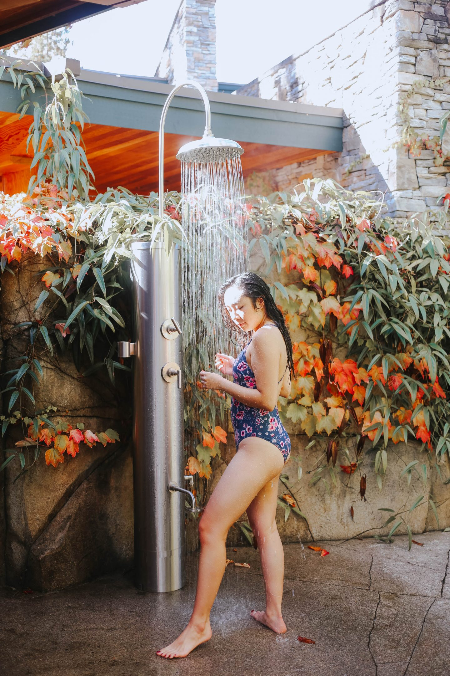 Using the outdoor rain shower at The Spa at the Painted Boat Resort on the Sunshine Coast BC