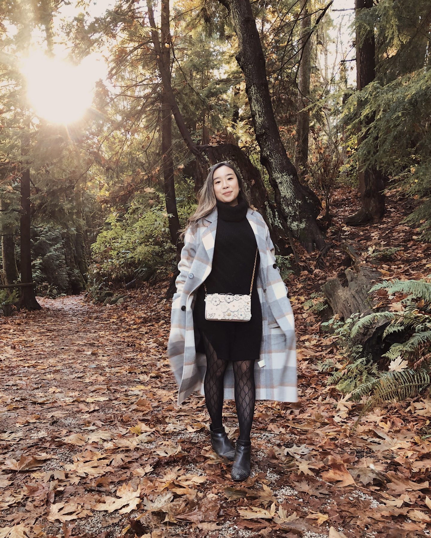 Strolling through the fall leaves with my fall plaid coat in the sun