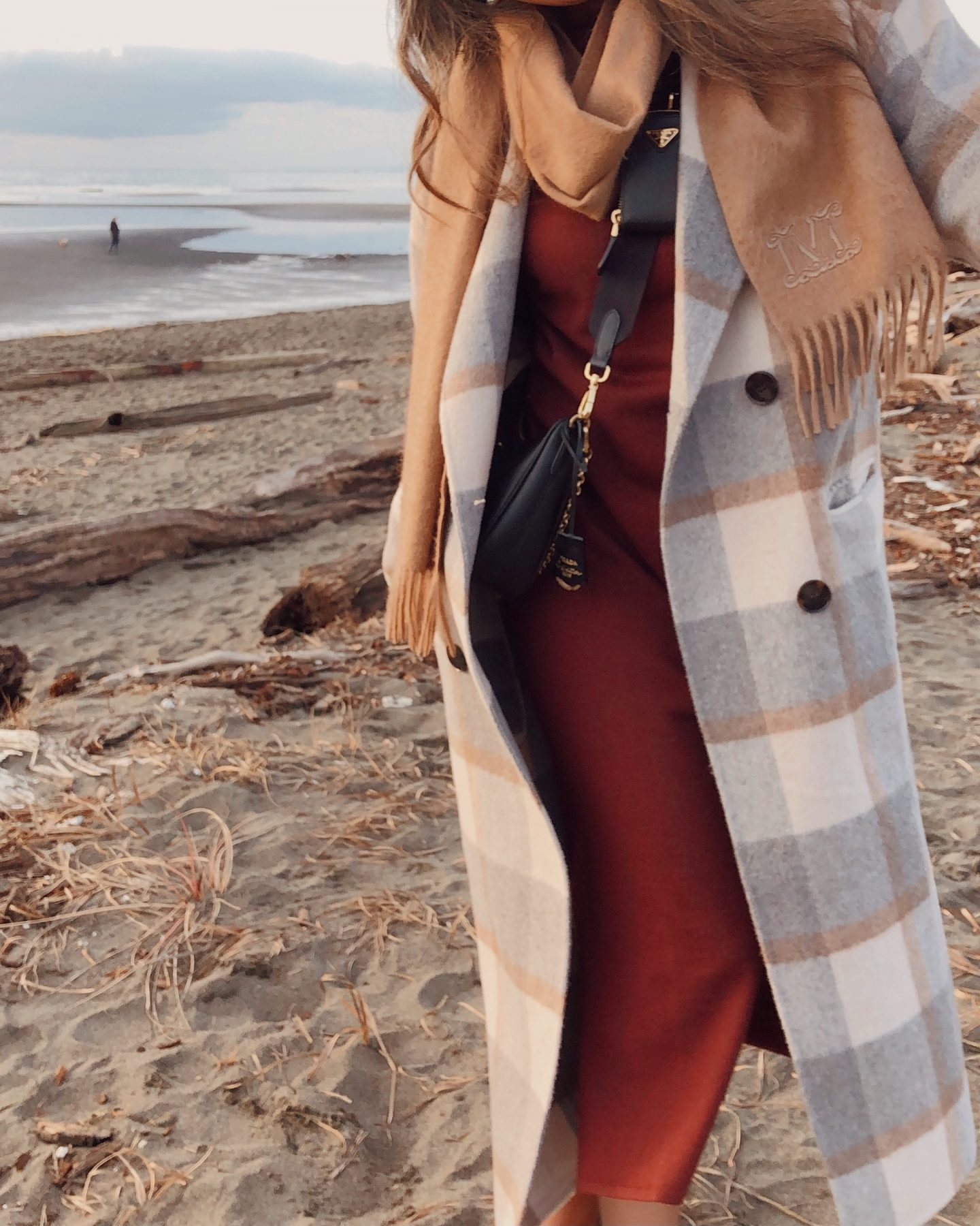 trying out a different photo angle on the beach with my plaid coat and scarf on a winter day