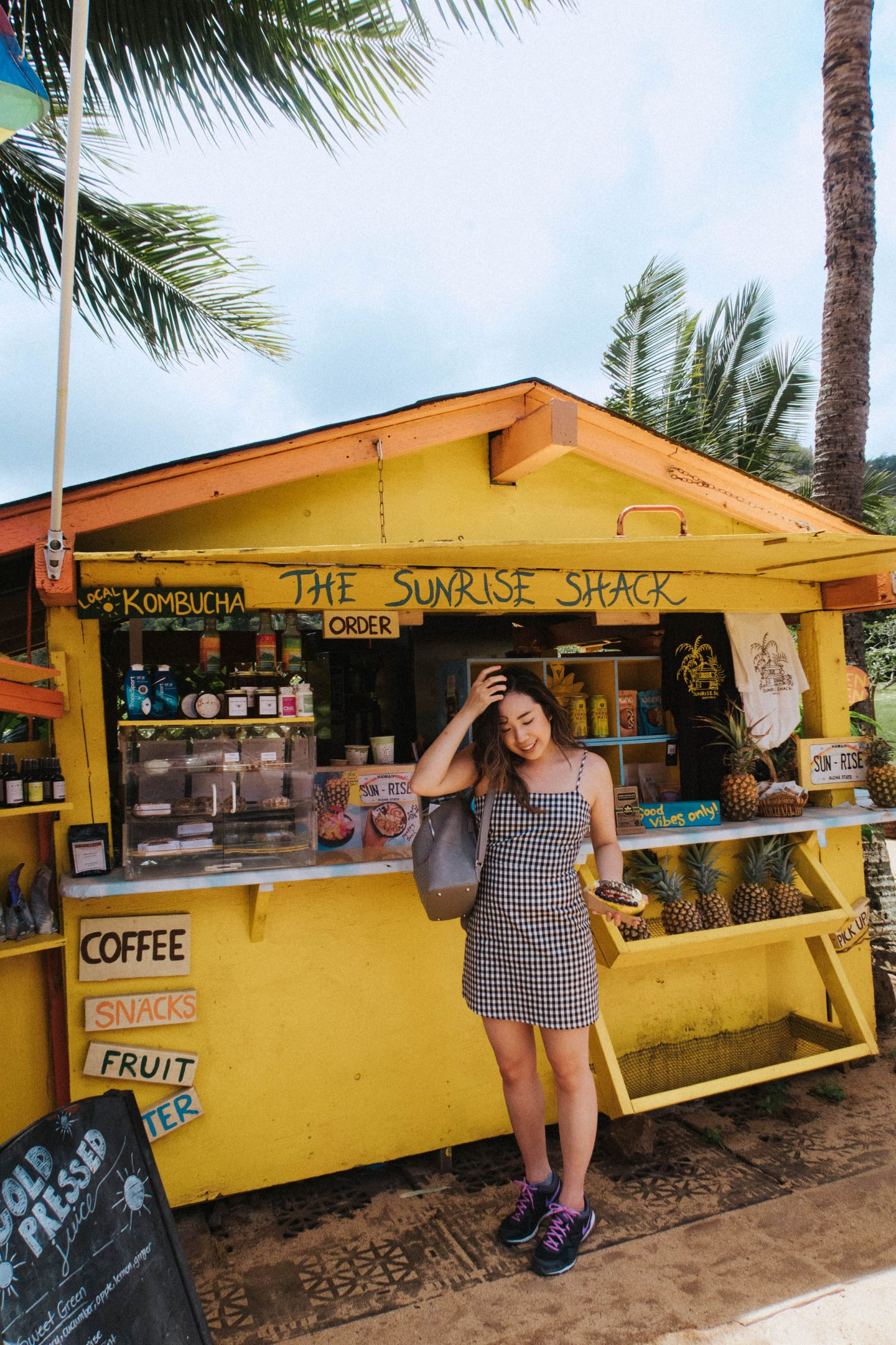 The must stop cute yellow shack of The Sunrise Shack on the drive to Oahu North Shore Hawaii