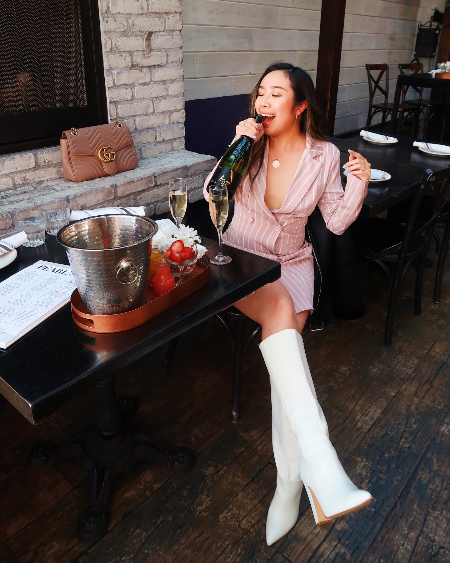 Doing Karaoke with a bottle of champagne with oysters in Los Angeles