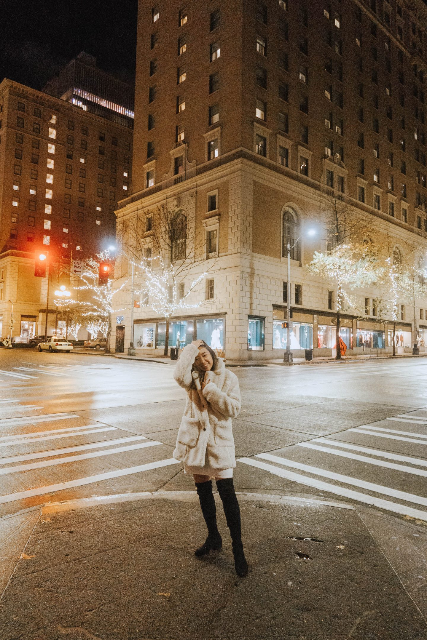 Posing on a street corner in downtown Seattle at night